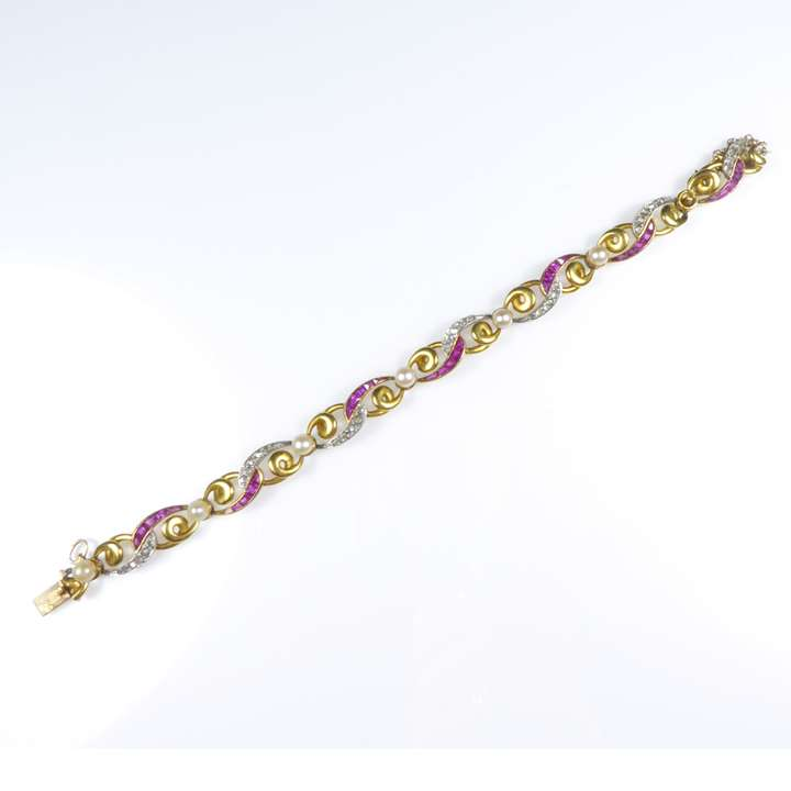 Antique gold, diamond and ruby oval scroll bracelet