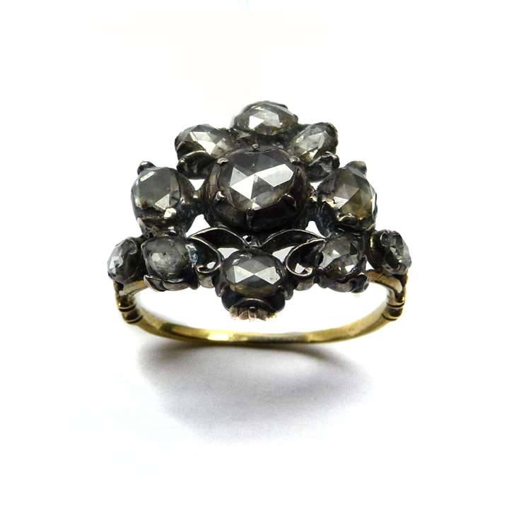 Antique rose diamond fancy cluster ring, as a vase of flowers with silver scrollwork