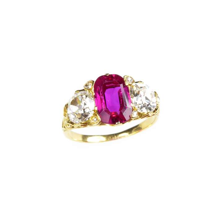 Antique ruby and diamond three stone ring, centred by an oblong cut Burma ruby