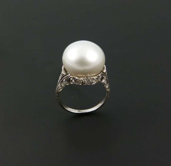 Antique single stone pearl and diamond ring