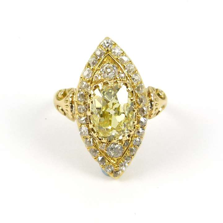 Antique yellow diamond and diamond cluster ring