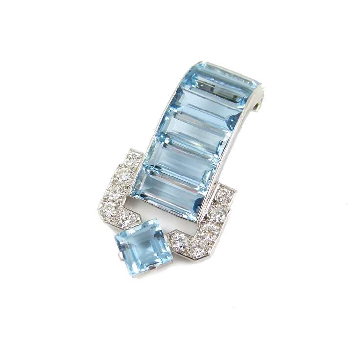 Aquamarine and diamond clip brooch of geometric buckle strap design