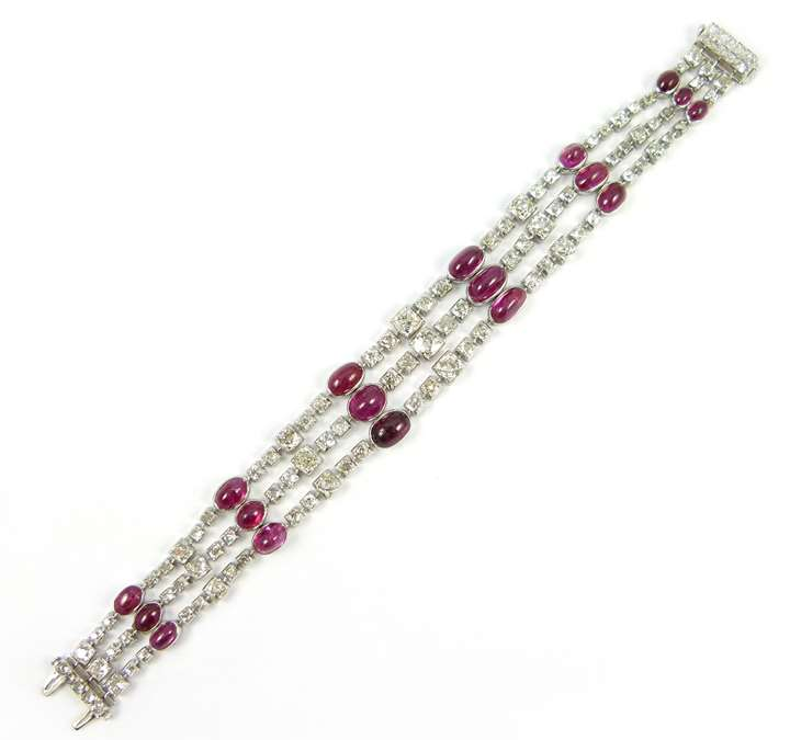 Art Deco cabochon ruby and box collet diamond three row bracelet