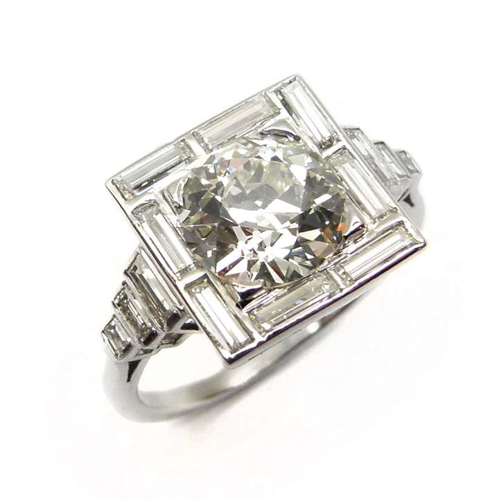 Art Deco cushion diamond and baguette diamond cluster ring