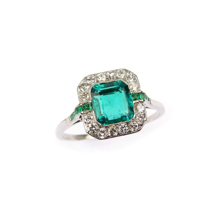 Art Deco emerald and diamond cluster ring with the 1.67ct trap-cut rectangular Colombian emerald
