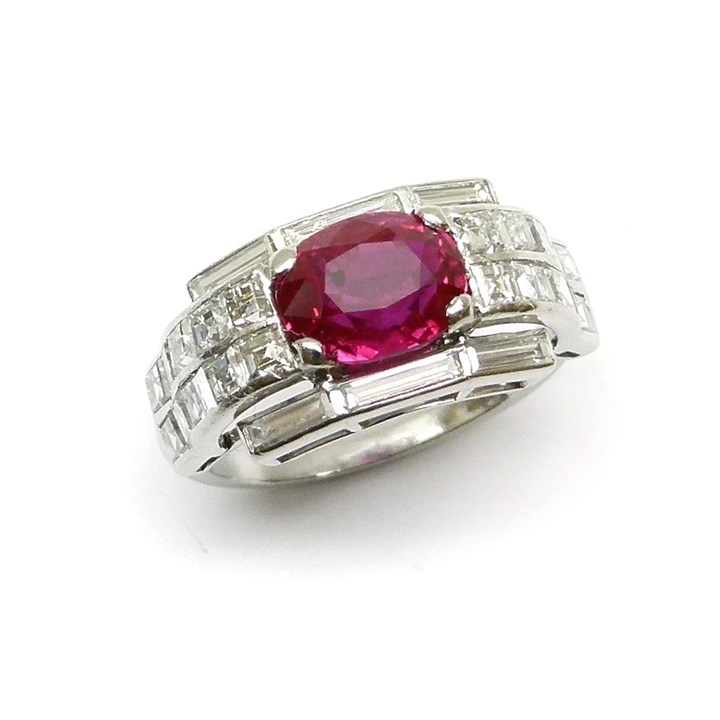 Art Deco ruby and diamond cluster ring, the cushion cut Burma ruby 2.12ct