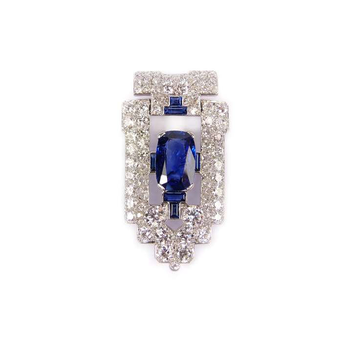 Art Deco sapphire and diamond clip brooch of geometric shield shape centred by a principal cushion cut 3.71ct Burma sapphire,