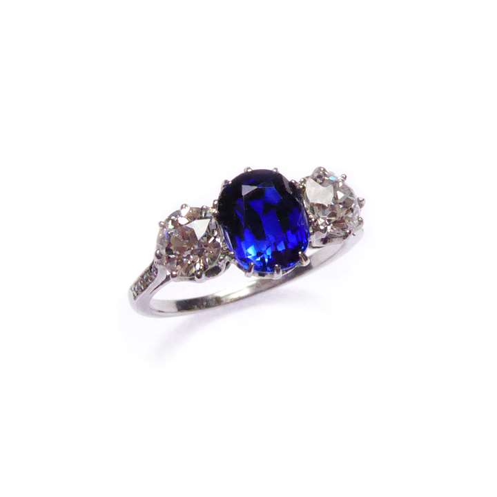 Art Deco sapphire and diamond three stone ring, centred by a cushion cut Ceylon sapphire,
