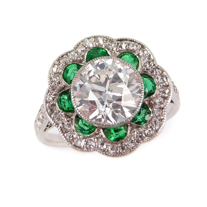 Art Deco single stone diamond and emerald flowerhead cluster ring