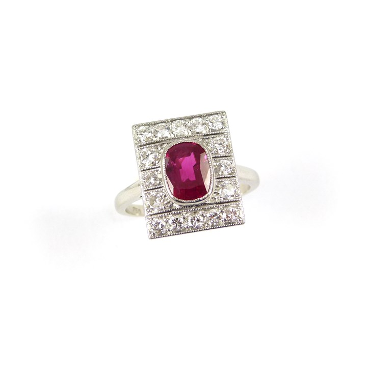 Art Deco single stone ruby and diamond panel ring, centred by a cushion cut Burma ruby, 1.50ct