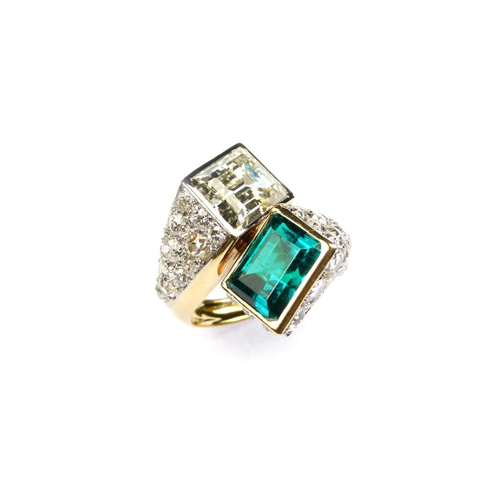 Art Deco two stone emerald and diamond crossover ring, Monture Cartier