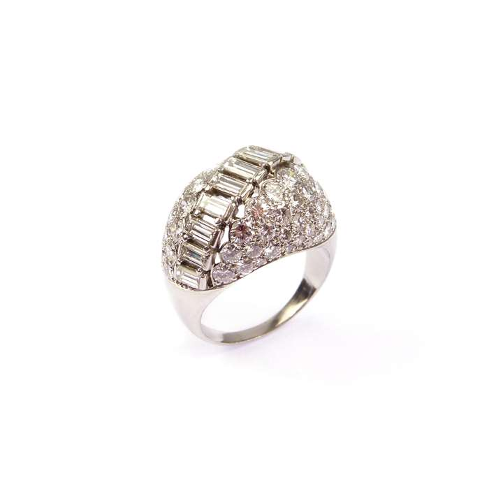 Bombe shaped diamond cluster ring with round brilliant and baguette diamonds