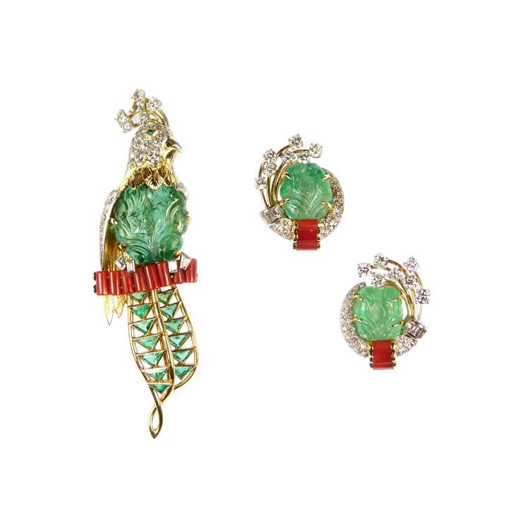Carved emerald, diamond and corallium rubrum exotic bird brooch and earrings en suite