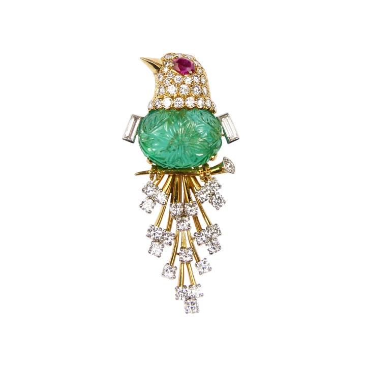 Carved emerald, diamond, ruby and gold bird brooch