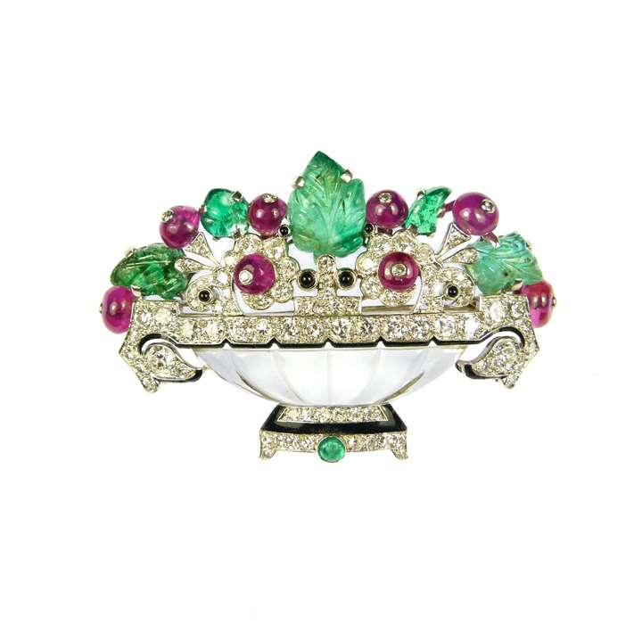 Carved emerald, ruby, diamond and rock crystal flower basket brooch by Cartier