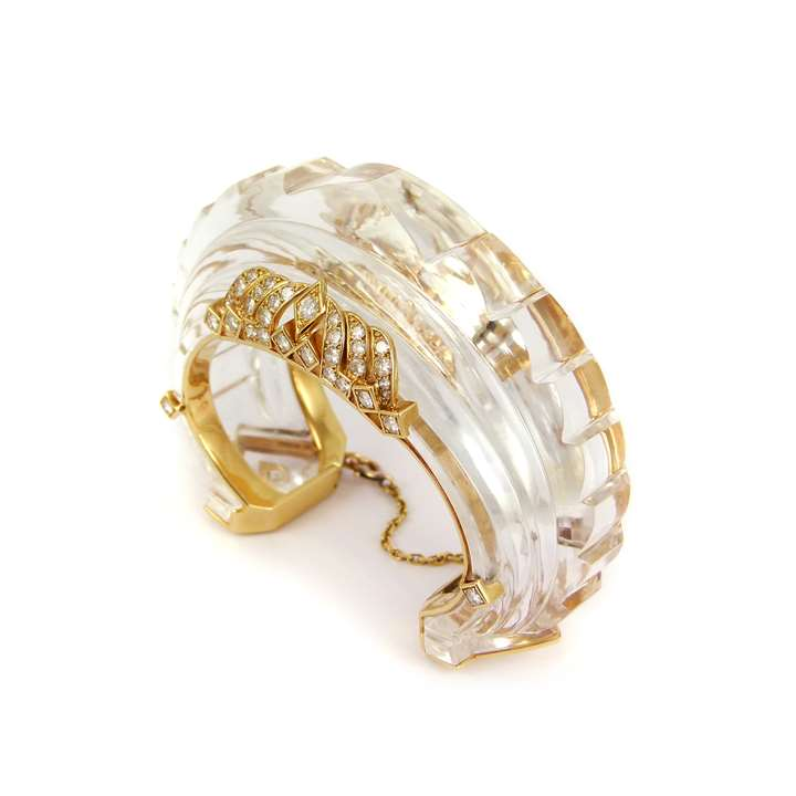 Carved rock crystal, diamond and gold architectural bangle
