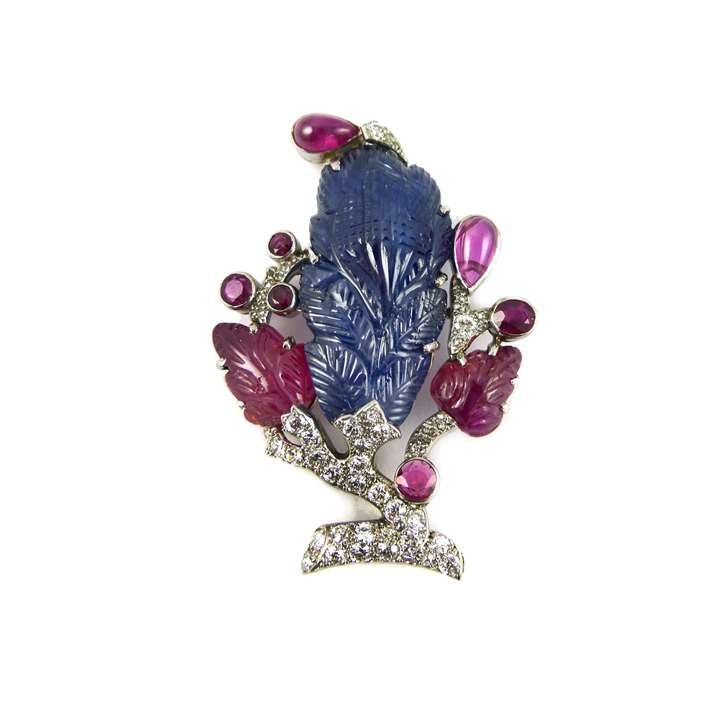 Carved sapphire, ruby and diamond brooch of foliate design
