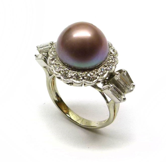 Coloured pearl and diamond cluster ring, central iridescent purplish grey domed pearl, 8.56cts
