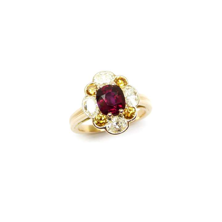 Cushion cut Burma ruby and diamond Oscar Heyman cluster ring, the central ruby 1.32cts,