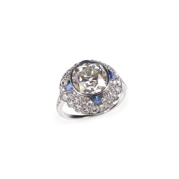 Cushion cut diamond, sapphire and diamond dome cluster ring