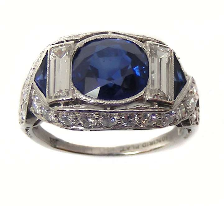 Cushion cut sapphire and diamond cluster ring