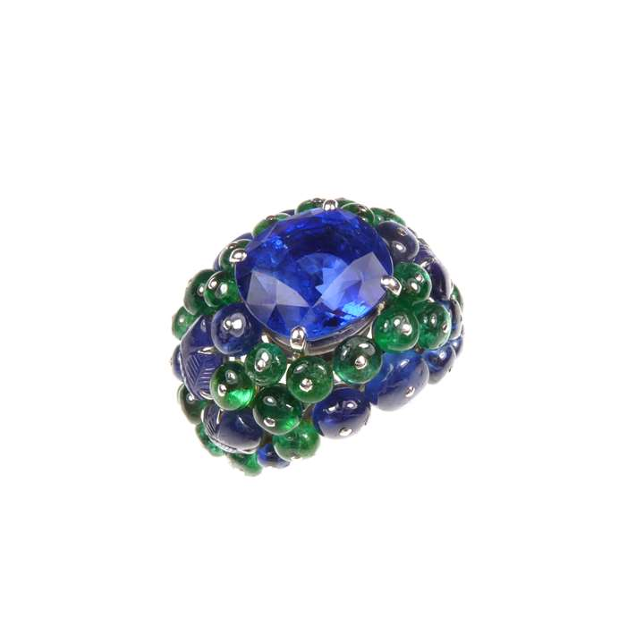 Cushion cut sapphire, emerald and sapphire bombe cluster ring by Cartier, the Ceylon sapphire, 11.08ct