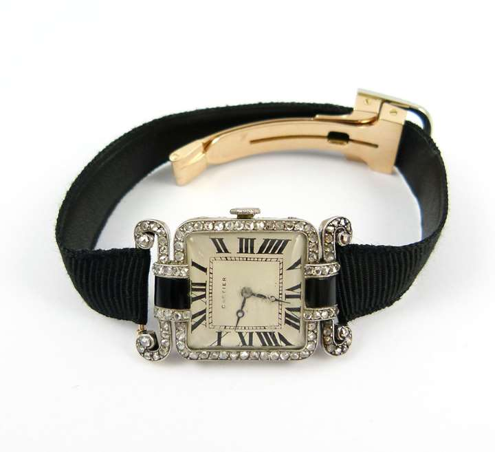 Diamond and onyx lady's wristwatch with Chinoiserie shoulders