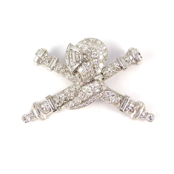Diamond and platinum knight's helmet and crossed batons brooch