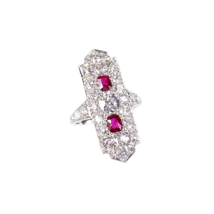Diamond and ruby panel ring by Cartier, the elongated rectangular panel featuring two cushion cut rubies,