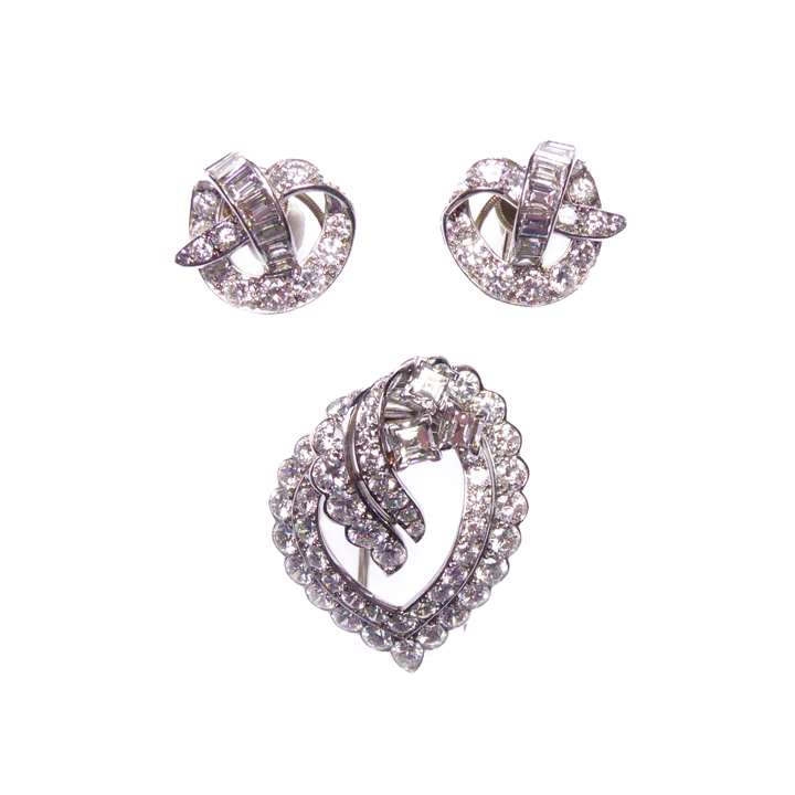 Diamond openwork scroll brooch and earrings en suite