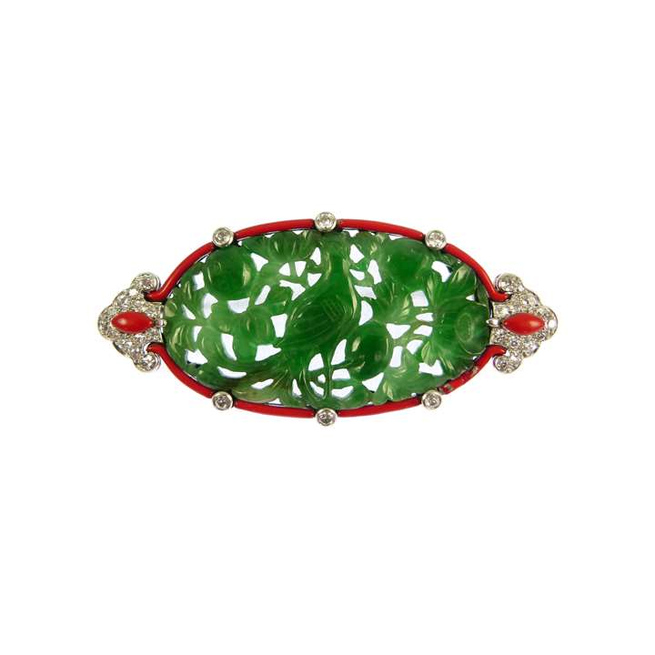 Diamond, red enamel and carved jade panel brooch by Cartier,