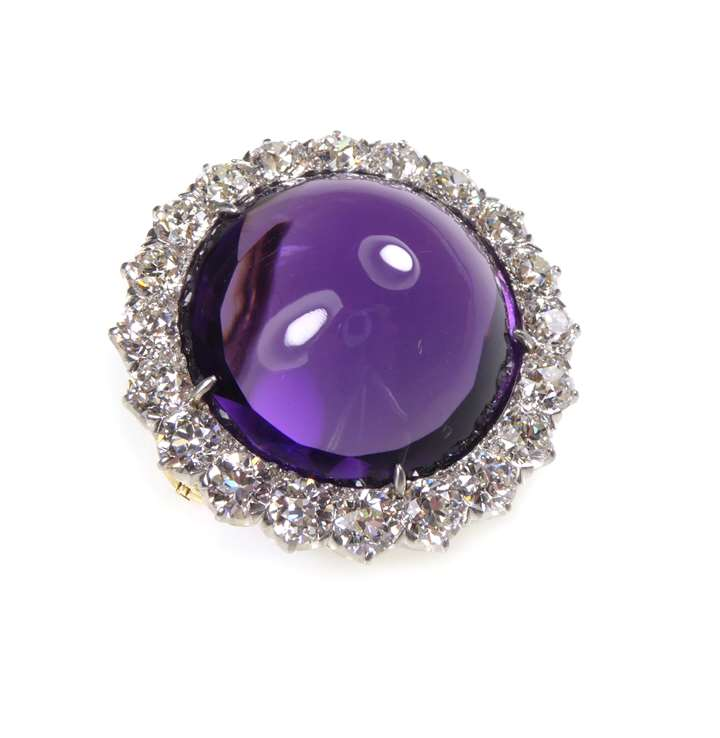 Cabochon amethyst and diamond cluster brooch