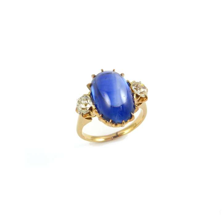 Early 20th century cabochon sapphire and diamond three stone ring
