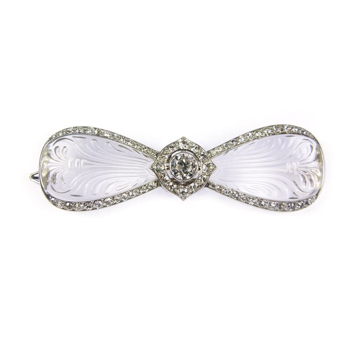 Early 20th century carved rock crystal and diamond bow brooch
