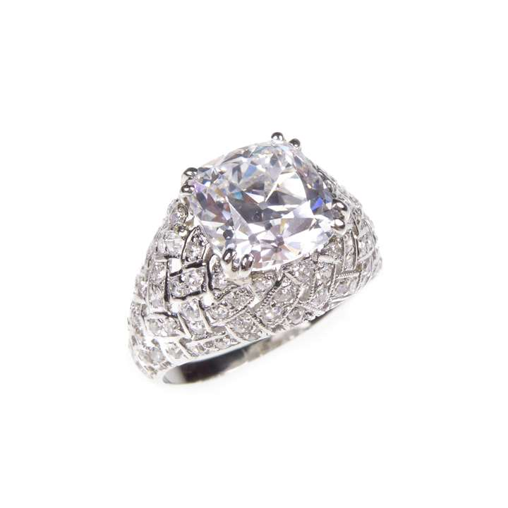 Square cushion cut diamond bombe ring, claw set with a 2.69ct, D VVS2