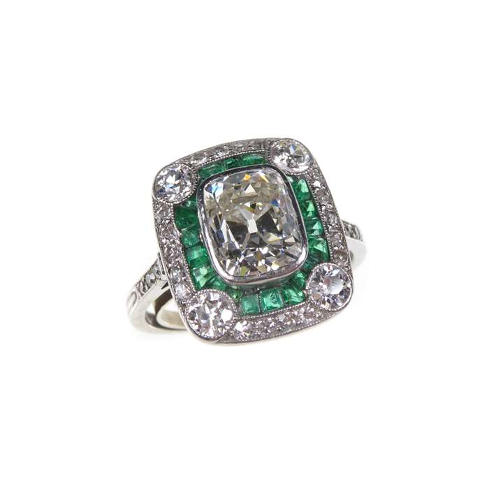 Diamond and emerald cluster ring