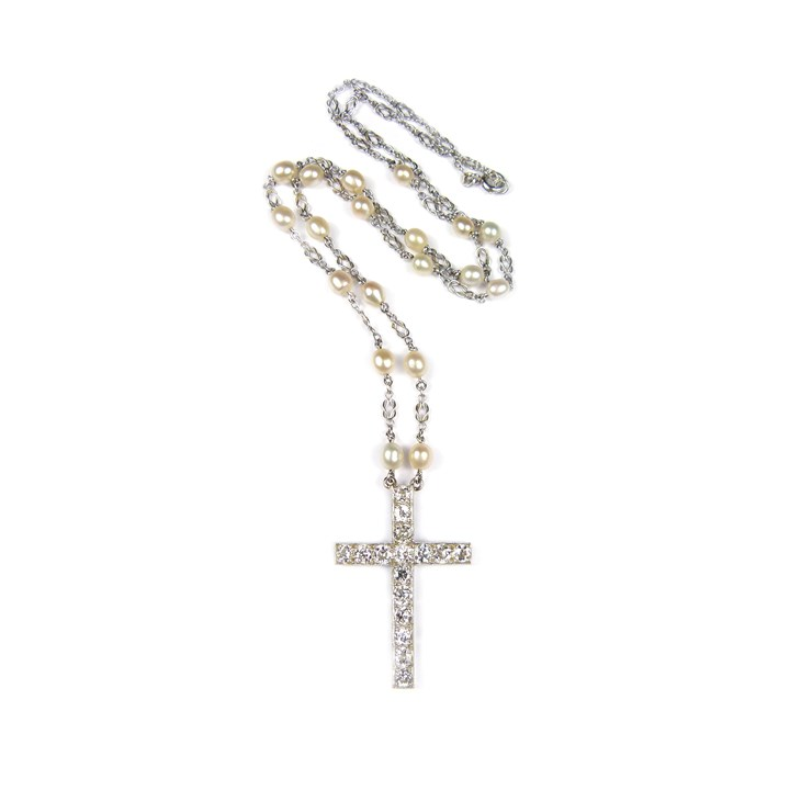 Early 20th century diamond cross pendant on a pearl set platinum chain necklace