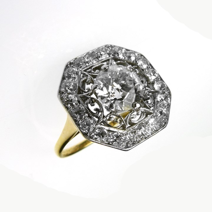 Early 20th century diamond set octagonal cluster ring, centred by a round brilliant cut 1.53ct I VS2 diamond