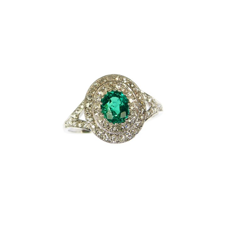 Early 20th century emerald and diamond cluster ring