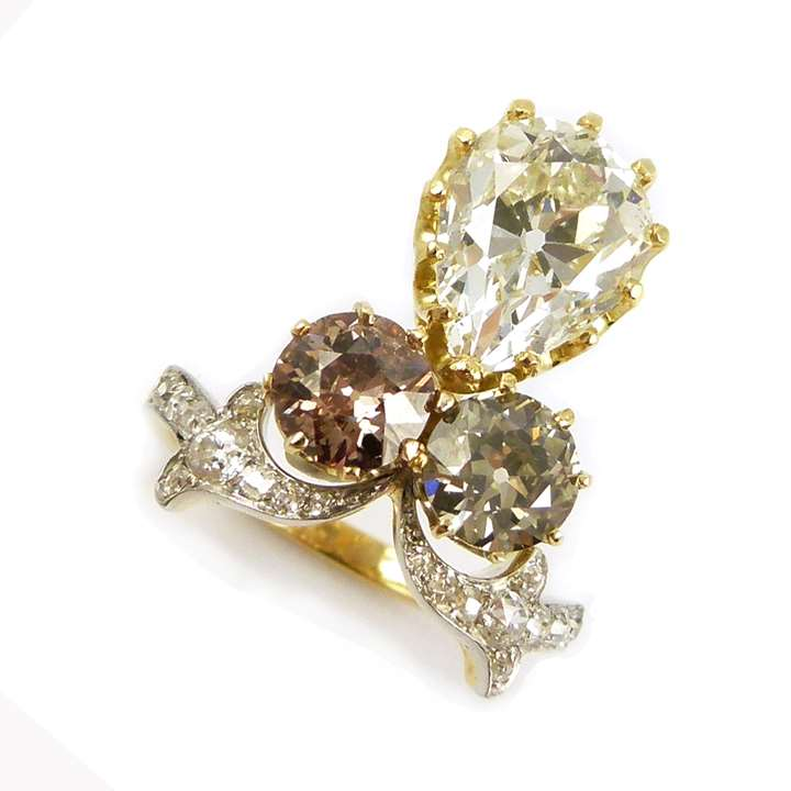 Pear shaped diamond and coloured diamond cluster ring