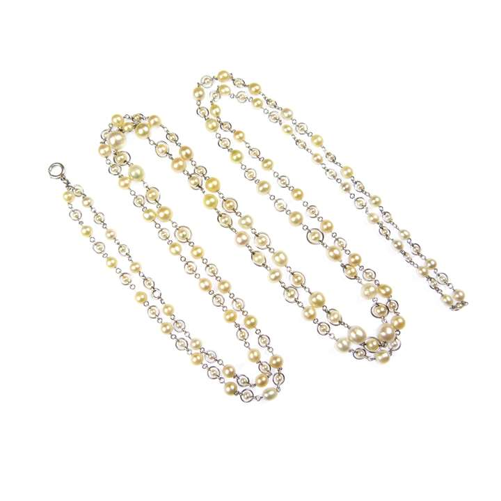 Early 20th century pearl and platinum long chain necklace