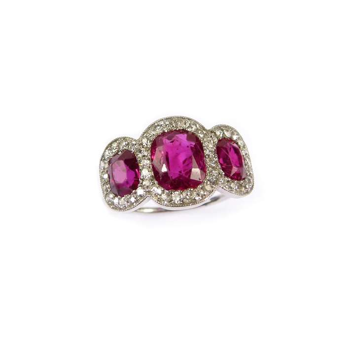 Early 20th century ruby and diamond three stone cluster ring