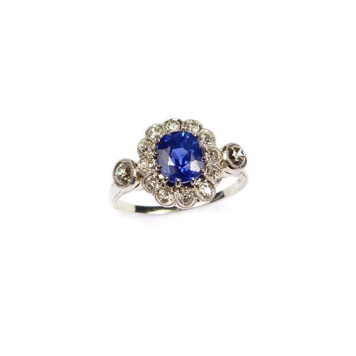 Sapphire and diamond cluster ring, the cushion cut Kashmir sapphire