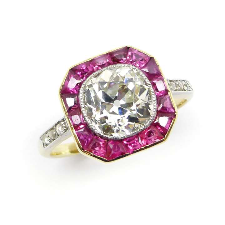 Early 20th century single stone cushion cut diamond and ruby cluster ring