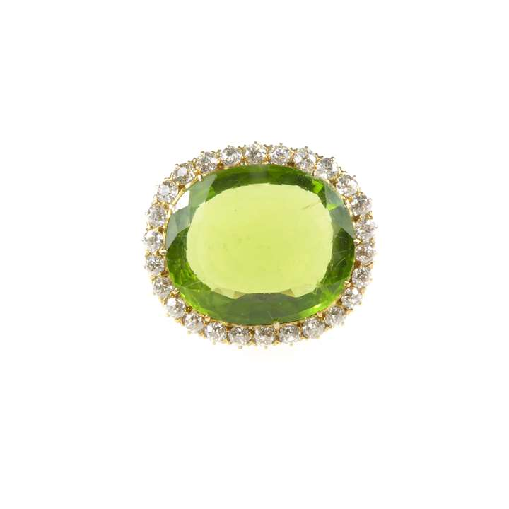 Early 20th century single stone peridot and diamond cluster brooch