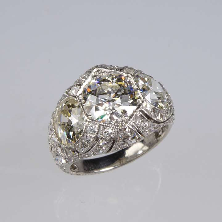 Early 20th century three stone diamond pierced cluster ring