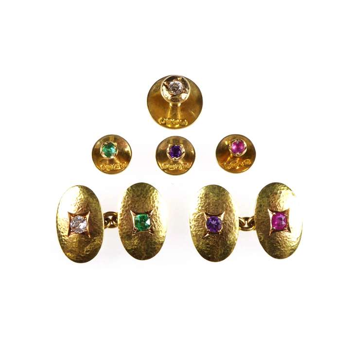 Edwardian gold and acrostic gem set gentleman's matched dress set the links by C D Saunders & J F H Shepherd, the studs by Swan Bros., the gem stones spelling out 'DEAR'