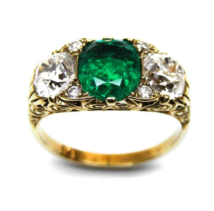 Emerald and diamond three stone carved gold half hoop ring