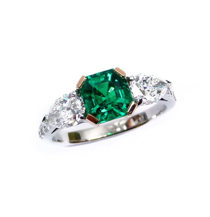 Emerald and diamond three stone ring, centred by a square trap cut emerald | MasterArt