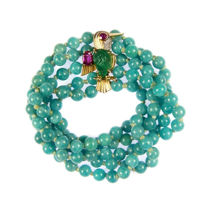 Cartier - Emerald, ruby and diamond bird brooch clasp on a multi-row amazonite bead bracelet | MasterArt
